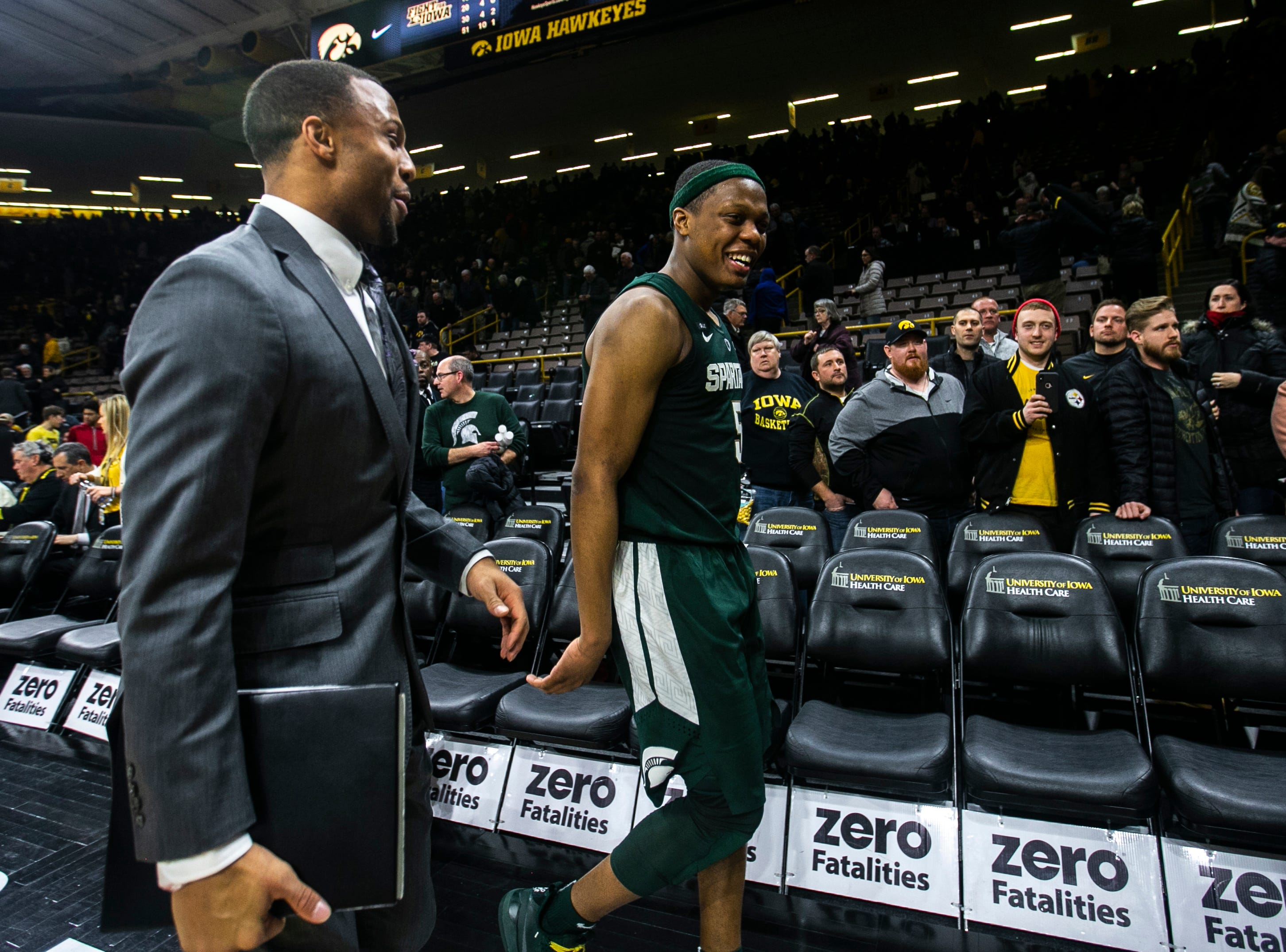 Michigan State guard Cassius Winston (5) smiles while walking off the court during a NCAA Big Ten Conference men's basketball game on Thursday, Jan. 24, 2019, at Carver-Hawkeye Arena in Iowa City, Iowa.