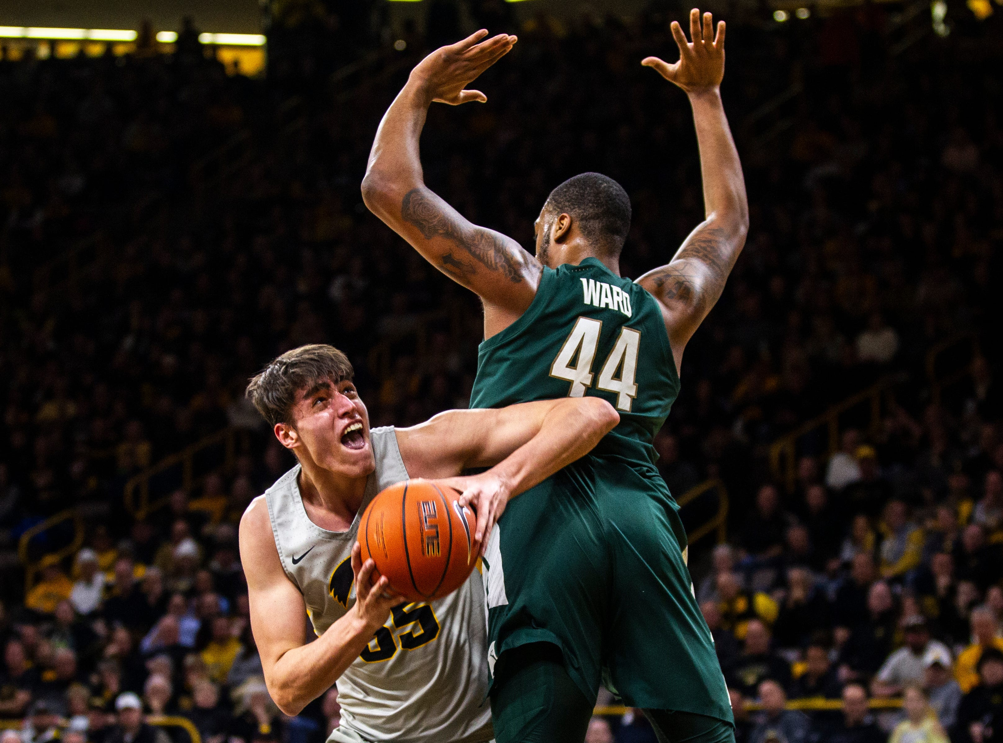Iowa forward Luka Garza (55) drives to the basket past Michigan State forward Nick Ward (44) during a NCAA Big Ten Conference men's basketball game on Thursday, Jan. 24, 2019, at Carver-Hawkeye Arena in Iowa City, Iowa.