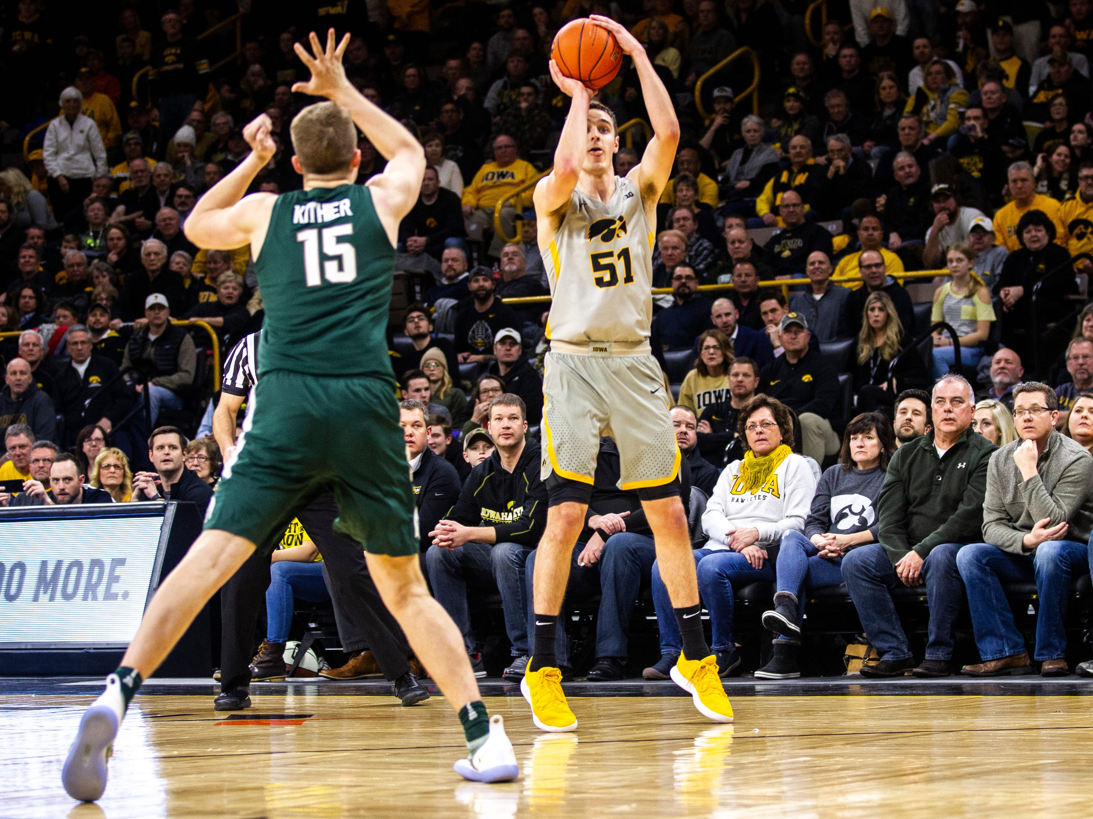 Iowa forward Nicholas Baer (51) shoots a 3-point basket during a NCAA Big Ten Conference men's basketball game on Thursday, Jan. 24, 2019, at Carver-Hawkeye Arena in Iowa City, Iowa.