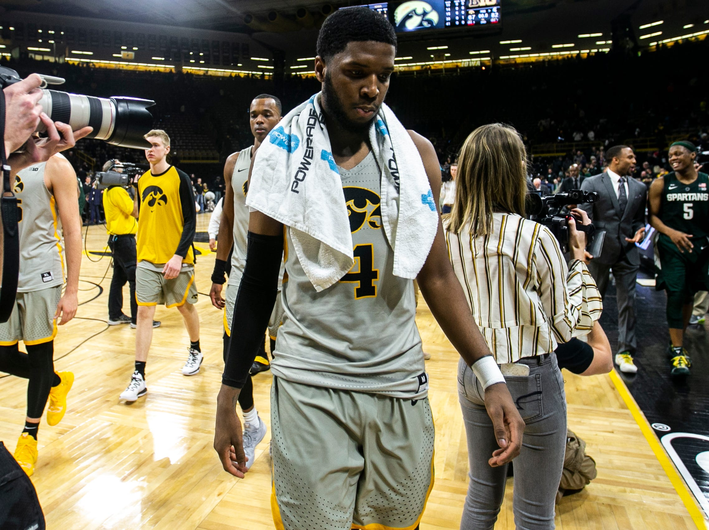 Iowa guard Isaiah Moss (4) walks off the court during a NCAA Big Ten Conference men's basketball game on Thursday, Jan. 24, 2019, at Carver-Hawkeye Arena in Iowa City, Iowa.
