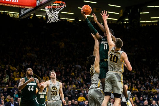 Michigan State freshman Aaron Henrys splits two defenders to score and tie the game 50-50 during the second half Thursday night at Iowa.