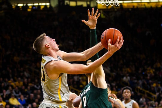 Iowa freshman Joe Wieskamp drove past Michigan State's Kyle Ahrens for this challenging second-half layup Thursday. He was held to five points, but is averaging 11.5 and staking his claim as one of the best rookies to ever play for the Hawkeyes.
