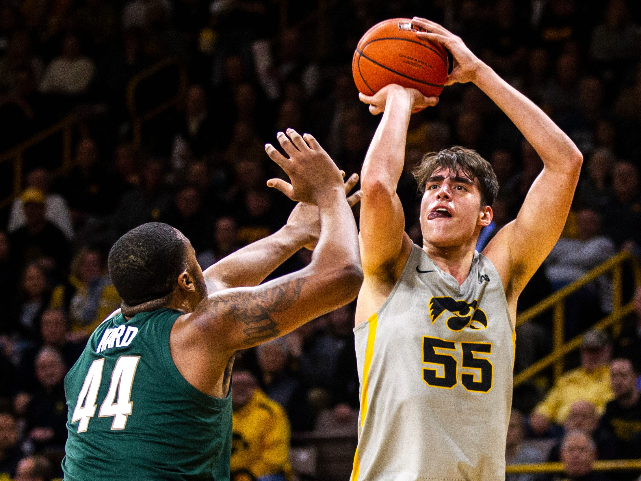 Iowa forward Luka Garza (55) attempts a basket while being defended by Michigan State forward Nick Ward (44) during a NCAA Big Ten Conference men's basketball game on Thursday, Jan. 24, 2019, at Carver-Hawkeye Arena in Iowa City, Iowa.