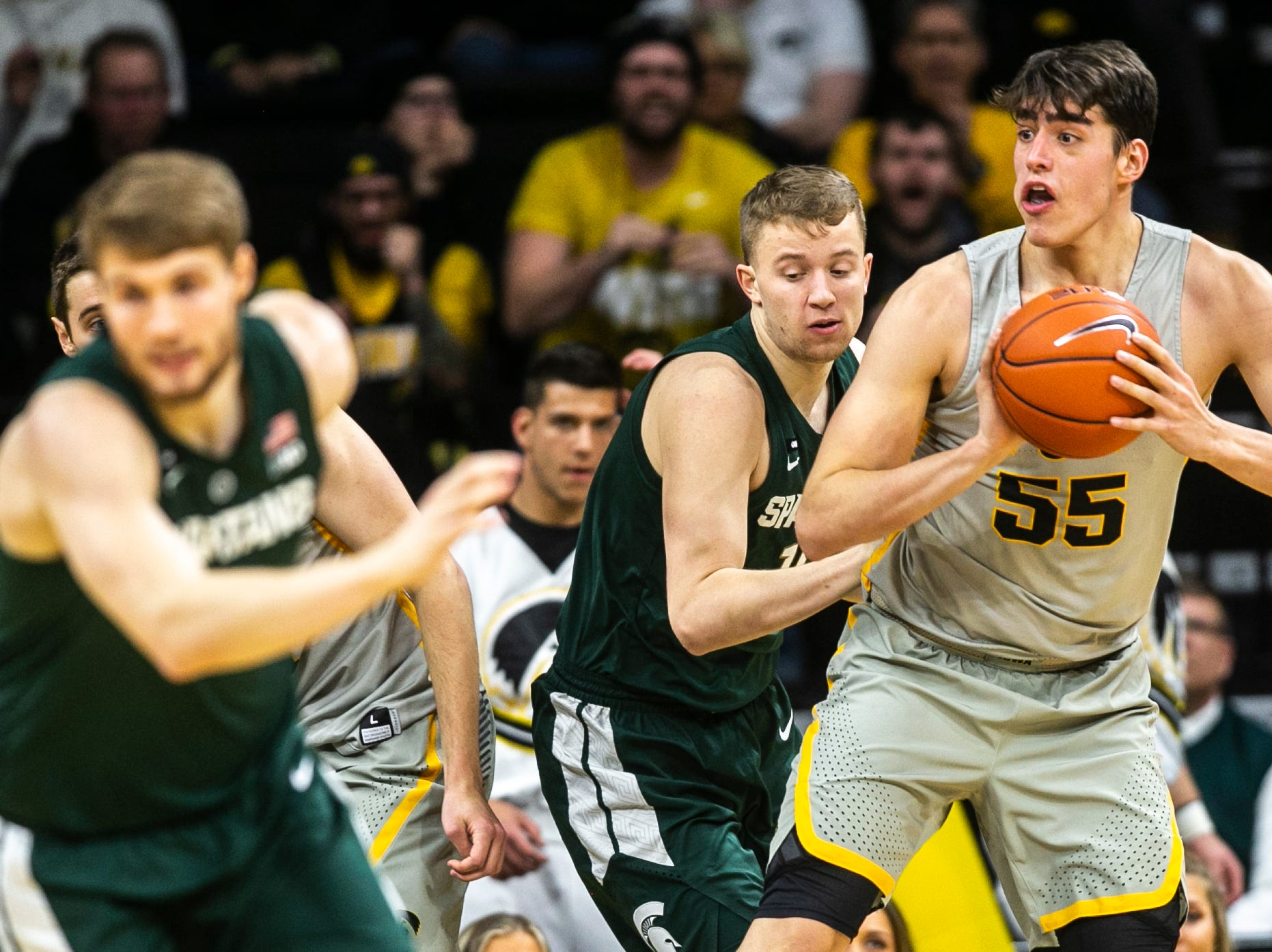 Iowa forward Luka Garza (55) grabs a rebound during a NCAA Big Ten Conference men's basketball game on Thursday, Jan. 24, 2019, at Carver-Hawkeye Arena in Iowa City, Iowa.