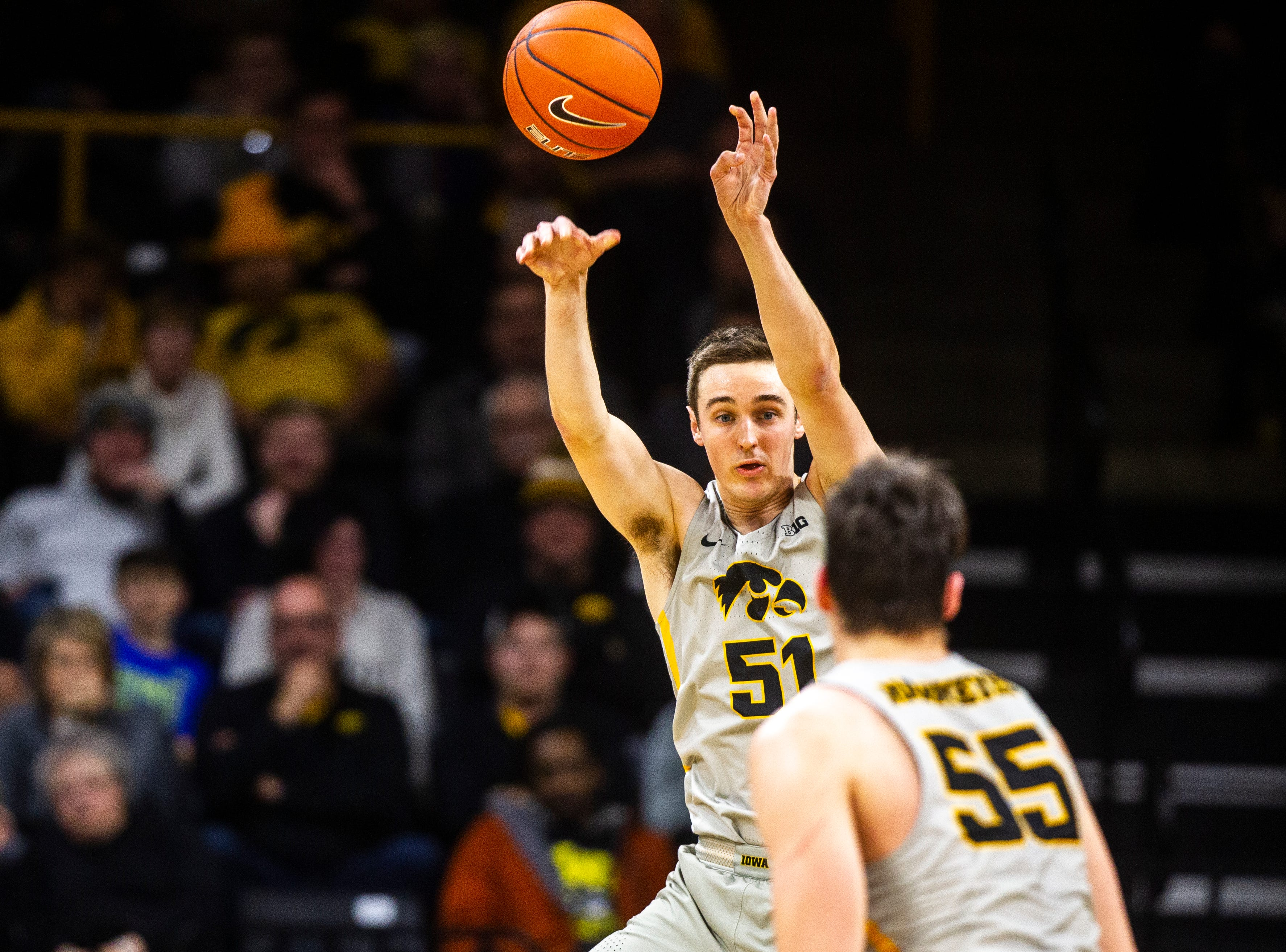 Iowa forward Nicholas Baer (51) shoots a pass out to Iowa forward Luka Garza (55) during a NCAA Big Ten Conference men's basketball game on Thursday, Jan. 24, 2019, at Carver-Hawkeye Arena in Iowa City, Iowa.