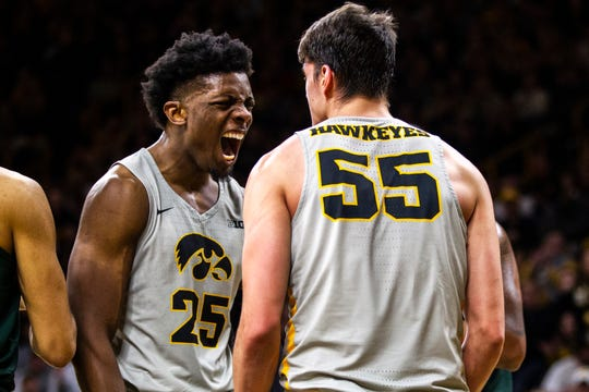Iowa forward Tyler Cook (25) celebrates with Iowa forward Luka Garza (55) after Garza drew a foul during a NCAA Big Ten Conference men's basketball game on Thursday, Jan. 24, 2019, at Carver-Hawkeye Arena in Iowa City, Iowa.