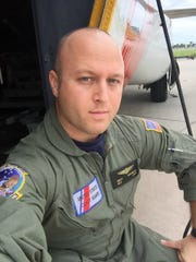 Matthew Overmyer on the steps of a C-130H while leading a Coast Guard training in Clearwater, Fla.
