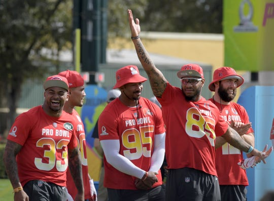Jan 23, 2019; Kissimmee, FL, USA; New York Jets safety Jamal Adams (33) and Cleveland Browns defensive end Myles Garrett (95) and Indianapolis Colts tight end Eric Ebron (85) and quarterback Andrew Luck (12) react during the Pro Bowl Skills Challenge at ESPN Wide World of Sports Complex.
