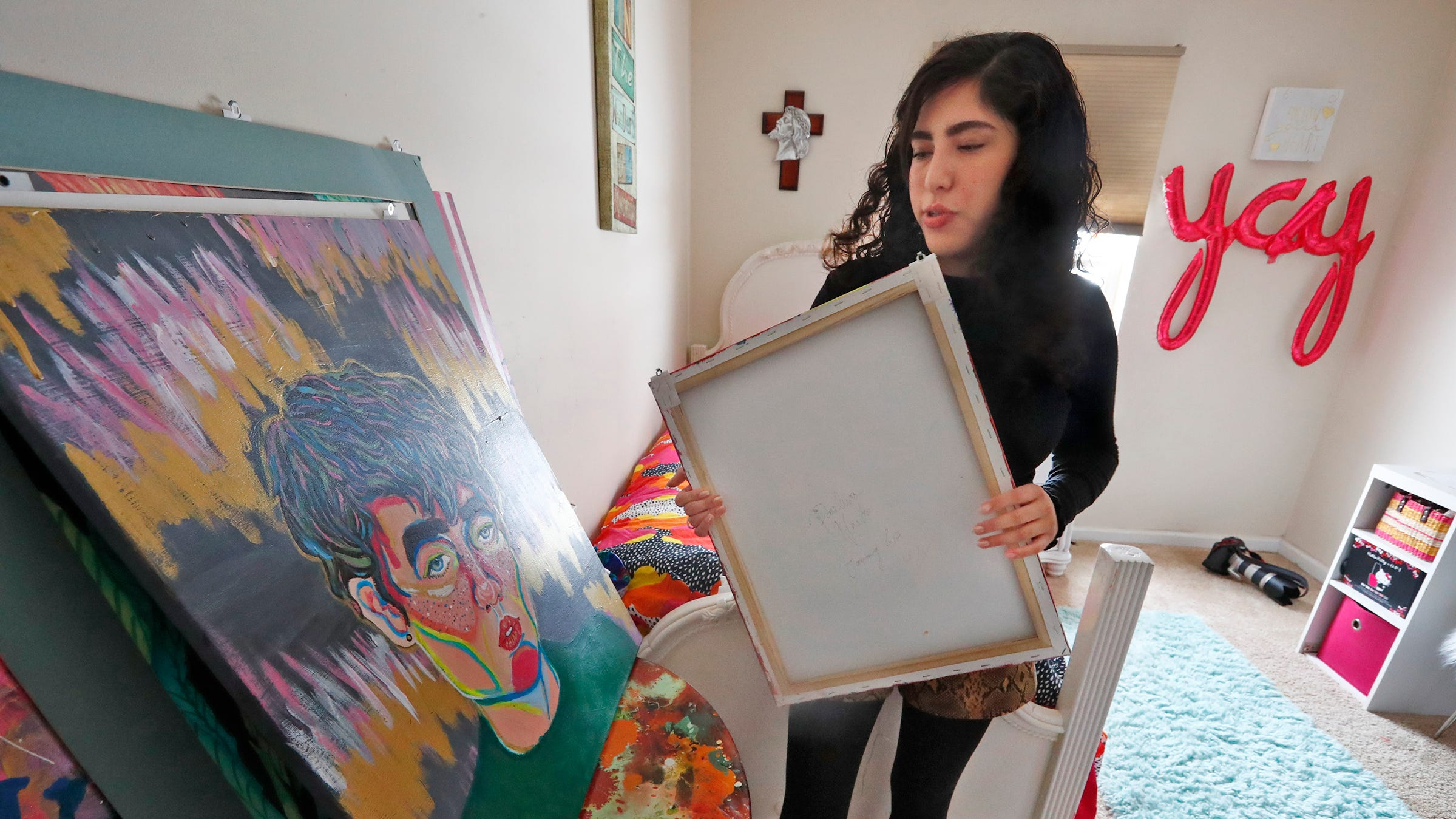 This teen was given a third chance on Earth. Here's why she's using it to teach art therapy.