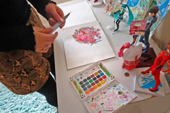 Paulina Nieto shows some of her artwork and supplies in her room in her Columbus home.