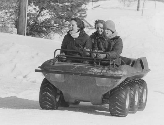 This six-wheel drive all-terrain vehicle was ideal for getting around in the snow during the blizzard of 1978. Tom Richart drives Cecilia (front) and Susan Richart (back) around Southport. Gary Moore/Indianapolis News