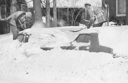 Mike and Gregory Howard have a big job of digging out these cars in the 4500 block of N. College Avenue following the blizzard of 1978.