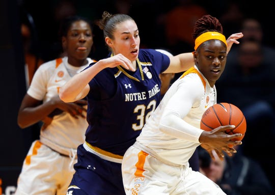 Tennessee forward Cheridene Green (15) works for a shot against Notre Dame forward Jessica Shepard (32) during the first half of an NCAA college basketball game Thursday, Jan. 24, 2019, in Knoxville, Tenn.