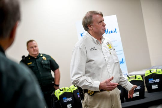 Sheriff John Mehr speaks about the importance of the AED devices at Madison County Sheriff's Offices in Denmark, Tenn., on Jan. 25, 2019.