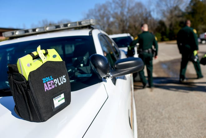 A donated AED device sits atop the hood of a Madison County Sheriff squad car at Madison County Sheriff's Offices in Denmark, Tenn., on Friday, Jan. 25, 2019.