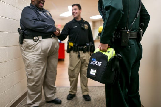 Madison County Sheriff's Deputies bring out the new AED devices to place them in cars at Madison County Sheriff's Offices in Denmark, Tenn., on Friday, Jan. 25, 2019.