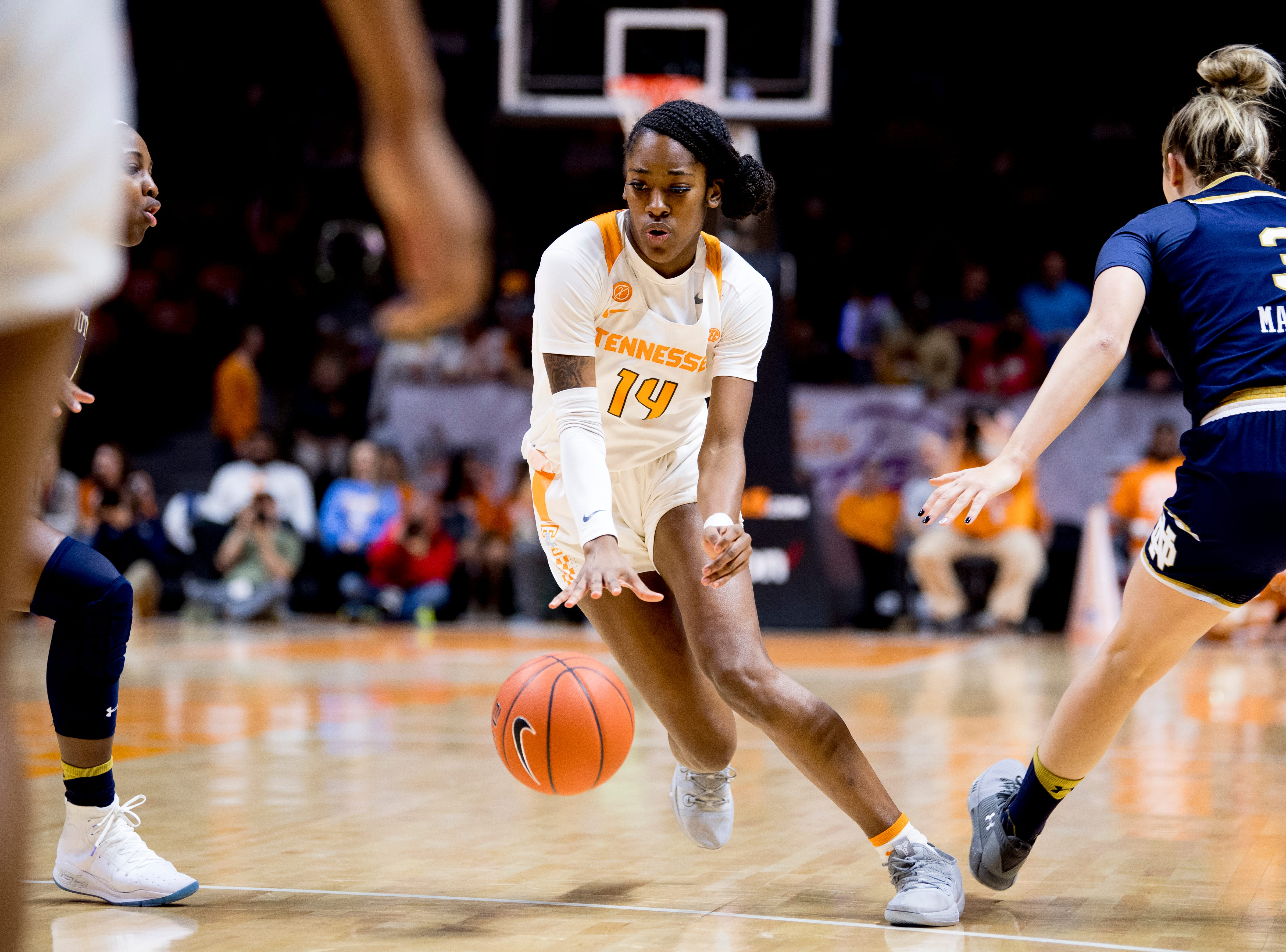 Tennessee guard Zaay Green (14) dribbles the ball past Notre Dame guard Marina Mabrey (3) during a game between Tennessee and Notre Dame at Thompson-Boling Arena in Knoxville, Tennessee on Thursday, January 24, 2019.