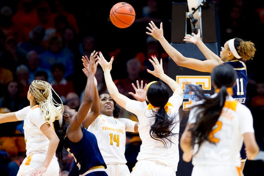 Players reach for the rebound ball during a game between Tennessee and Notre Dame at Thompson-Boling Arena in Knoxville, Tennessee on Thursday, January 24, 2019.