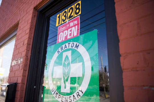 Signs mark the door at Noble Kava located on North Broadway Friday, Jan. 25, 2019. The bar had it's grand opening Friday.
