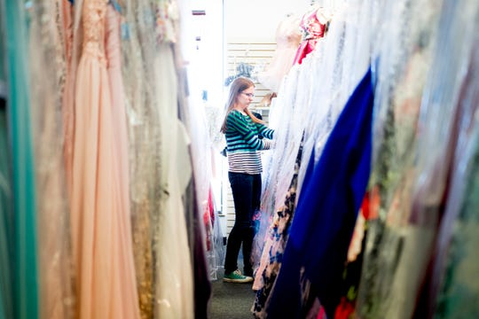 Macy Myers looks through a rack of prom dresses at Katie's Kloset in Tennessee on Jan. 25.