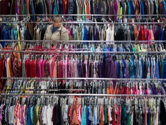 """A customer browses the clothing racks at the Karm store Farragut on Thursday, January 24, 2019. Many area resale stores have seen an increase in donations or consignments since the Netflix series, """"Tidying Up with Marie Kondo,"""" premiered on Jan. 1.In the first three weeks of 2019, KARM has seen60 percent more people make donationsthan in the same time period in 2018."""