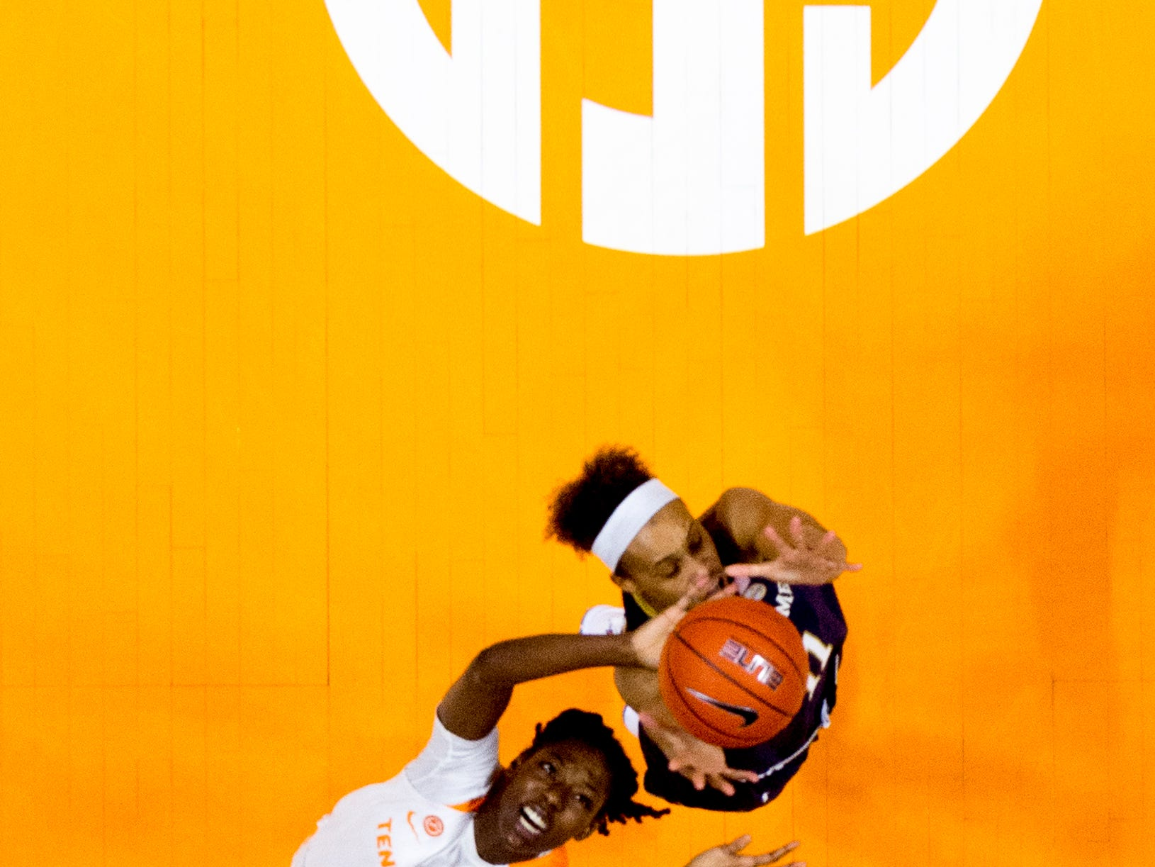 Tennessee guard/forward Rennia Davis (0) and Notre Dame forward Brianna Turner (11) reach for the ball during a game between Tennessee and Notre Dame at Thompson-Boling Arena in Knoxville, Tennessee on Thursday, January 24, 2019.