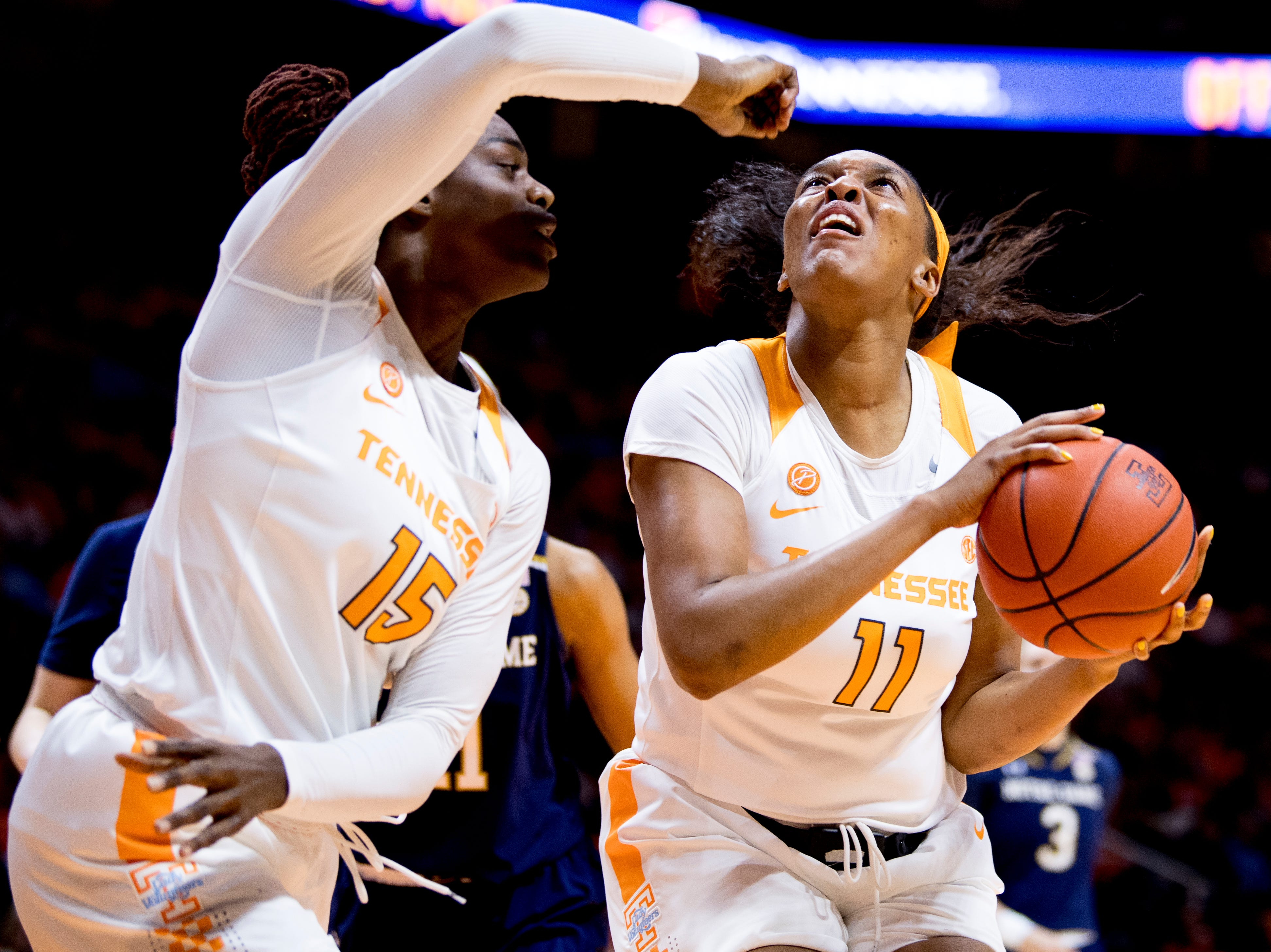 Tennessee center Kasiyahna Kushkituah (11) shoots the ball past Tennessee forward Cheridene Green (15) during a game between Tennessee and Notre Dame at Thompson-Boling Arena in Knoxville, Tennessee on Thursday, January 24, 2019.