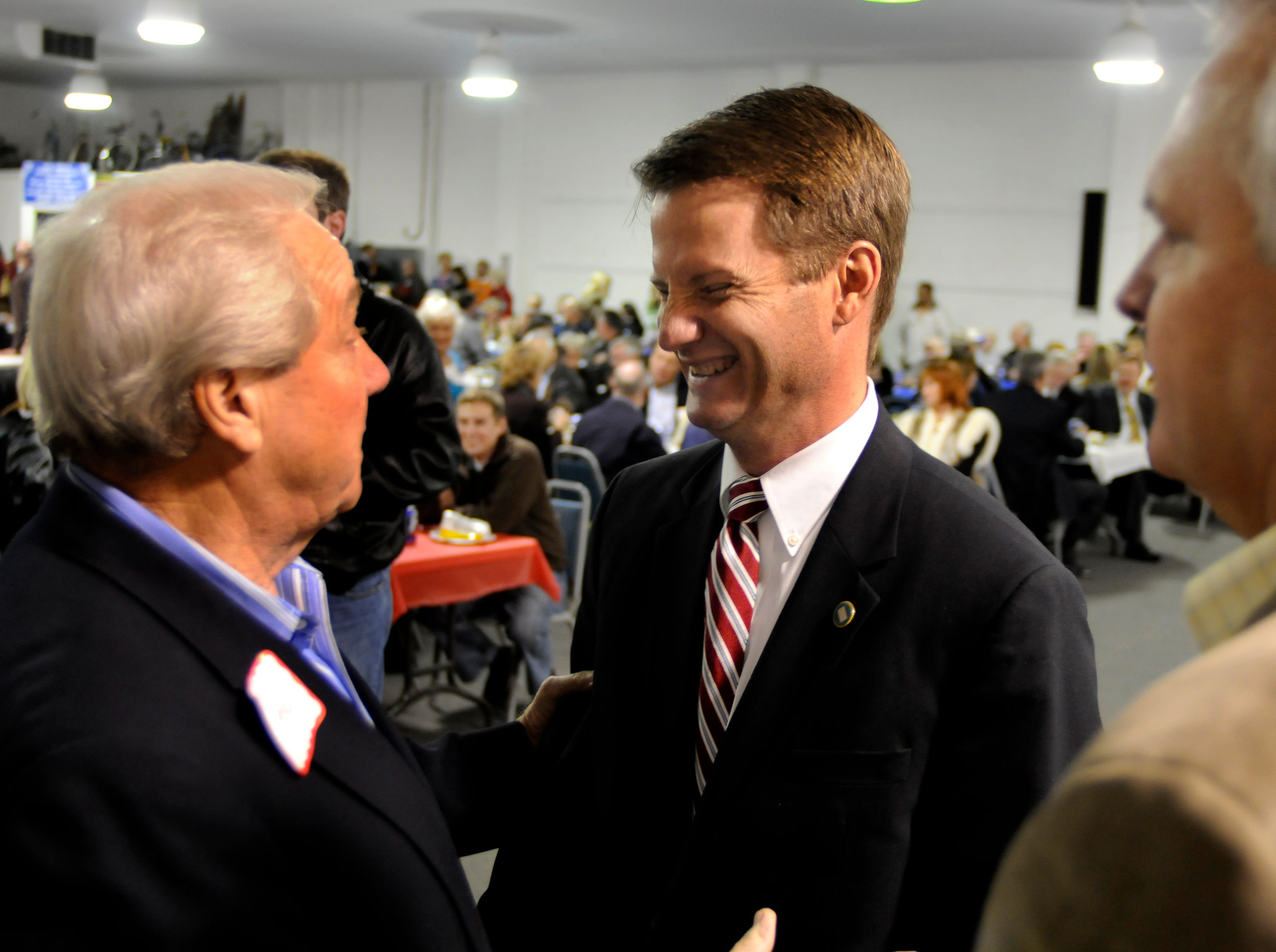 "Friday, November 21, 2008     State Sen. Tim Burchett, center, laughs at a joke told by former representative H.E. Bittle, left, at Burchett's announcement he is running for county mayor. The ""Bologna with the Burchetts"" kickoff was hosted by Howard Phillips at Powell Auction."