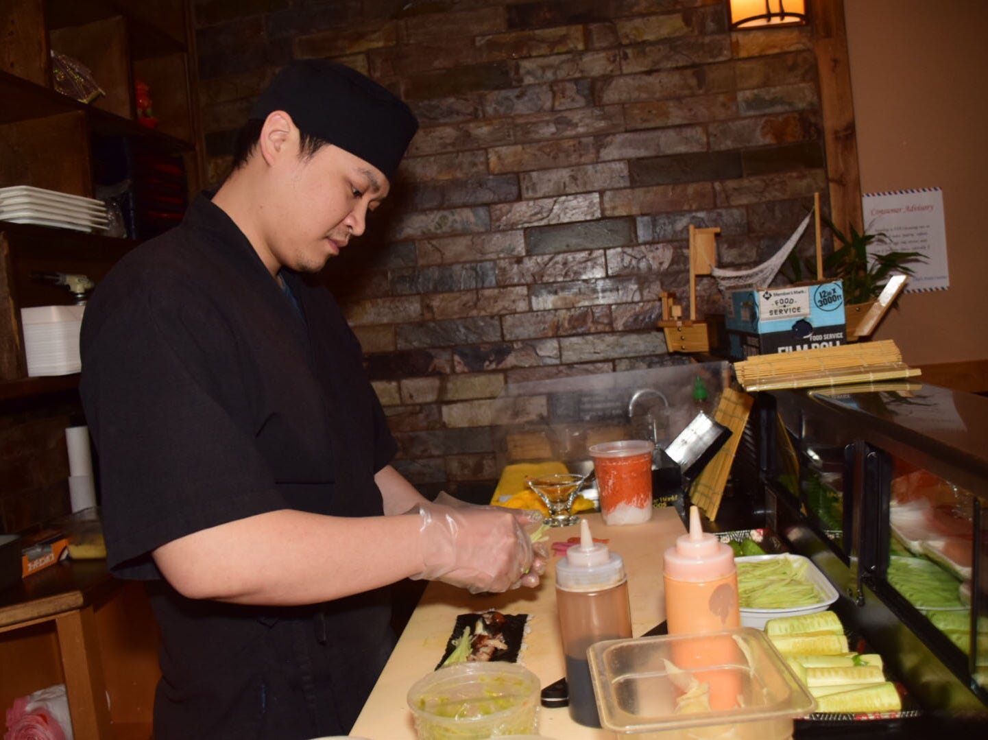 John Jiang prepares sushi made to order at Chef's Asian Cuisine Thursday, Jan. 24.