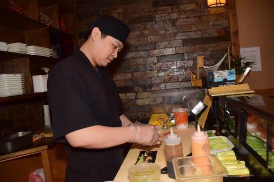 John Jiang prepares sushi made to order at Chef's Asian Cuisine Thursday, Jan. 24.