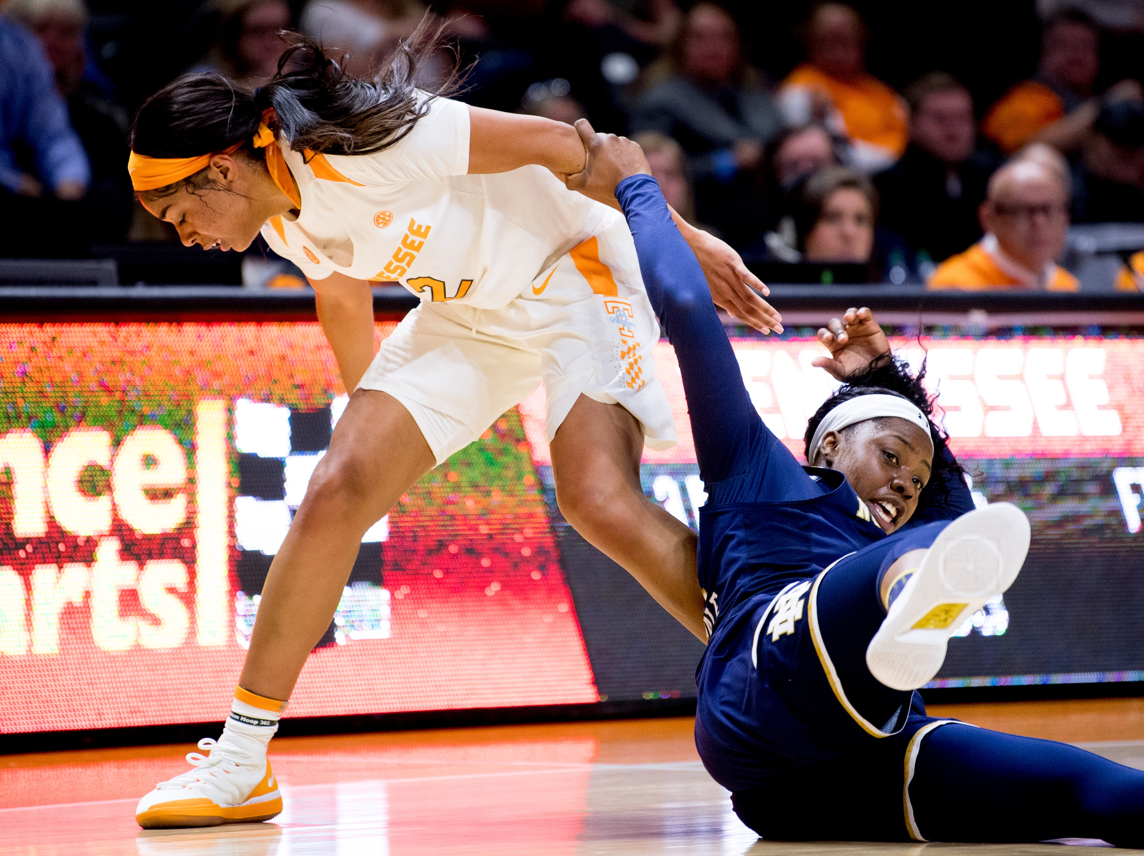 Tennessee guard Evina Westbrook (2) and Notre Dame guard Arike Ogunbowale (24) trip over one another during a game between Tennessee and Notre Dame at Thompson-Boling Arena in Knoxville, Tennessee on Thursday, January 24, 2019.