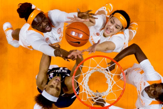 Tennessee forward Cheridene Green (15) and Tennessee forward Mimi Collins (4) reach for the ball during a game between Tennessee and Notre Dame at Thompson-Boling Arena in Knoxville, Tennessee on Thursday, January 24, 2019.