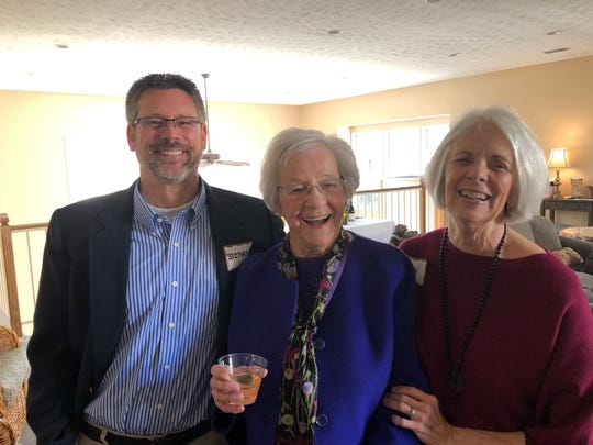 Mary with friends Steven and Bev Howard at her 102d birthday party.