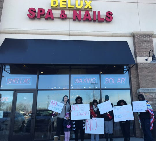Customers organized a protest after they felt they were racially discriminated against at Delux Spa & Nails.