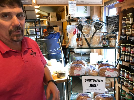 "Jerry Lecy, owner of Great Harvest Bread Co., talks about the Lafayette shop's, ""Shutdown Shelf,"" stocked with loaves of free bread for federal workers on furlough or working without paychecks since the start of a partial shutdown that started Dec. 22. The shelf went up a week ago at Great Harvest, 1500 Kossuth St."