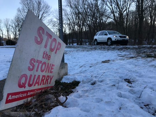The 'Stop the Stone Quarry' signs, such as this one along Old Indiana 25, might be starting to show their age after six years of the Americus Area Community Coalition's fight against a proposed quarry eight miles northeast of Lafayette.