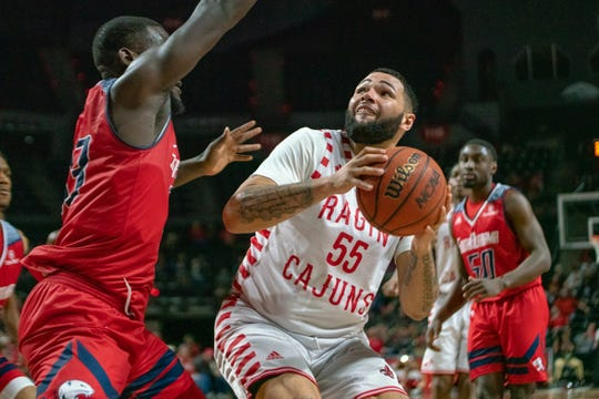 UL's Justin Miller prepares to take the ball to the basket during Thursday night's win over South Alabama.