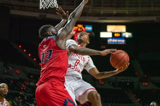 UL's Cedric Russell challenges a defender to get to the goal during the Jan. 24 game against South Alabama at the Cajundome.