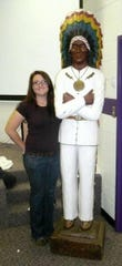 Bethany Frank stands with the statue of Caddo in 2009. She started college at Tyler Junior College in Texas and finished at Northwestern State University in 2010.