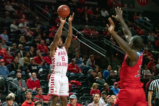 UL's P.J. Hardy scores from the three-point line as the Ragin' Cajuns play against the South Alabama Jaguars at the Cajundome on Jan. 24, 2019.