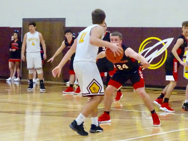 Berne Union's Zane Mirgon dribbles against Bishop Rosecrans' Weston Nern during Thursday's Mid-State League-Cardinal Division game. Nern scored 20 points to help lead the Bishops to a 56-44 win.