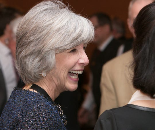 The 2018 Howell Area Chamber of Commerce Citizen of the Year, Carol Griffith, shares a laugh after receiving the honor at the chamber's annual awards dinner Thursday, Jan. 24, 2019 at Crystal Gardens Banquet Center.