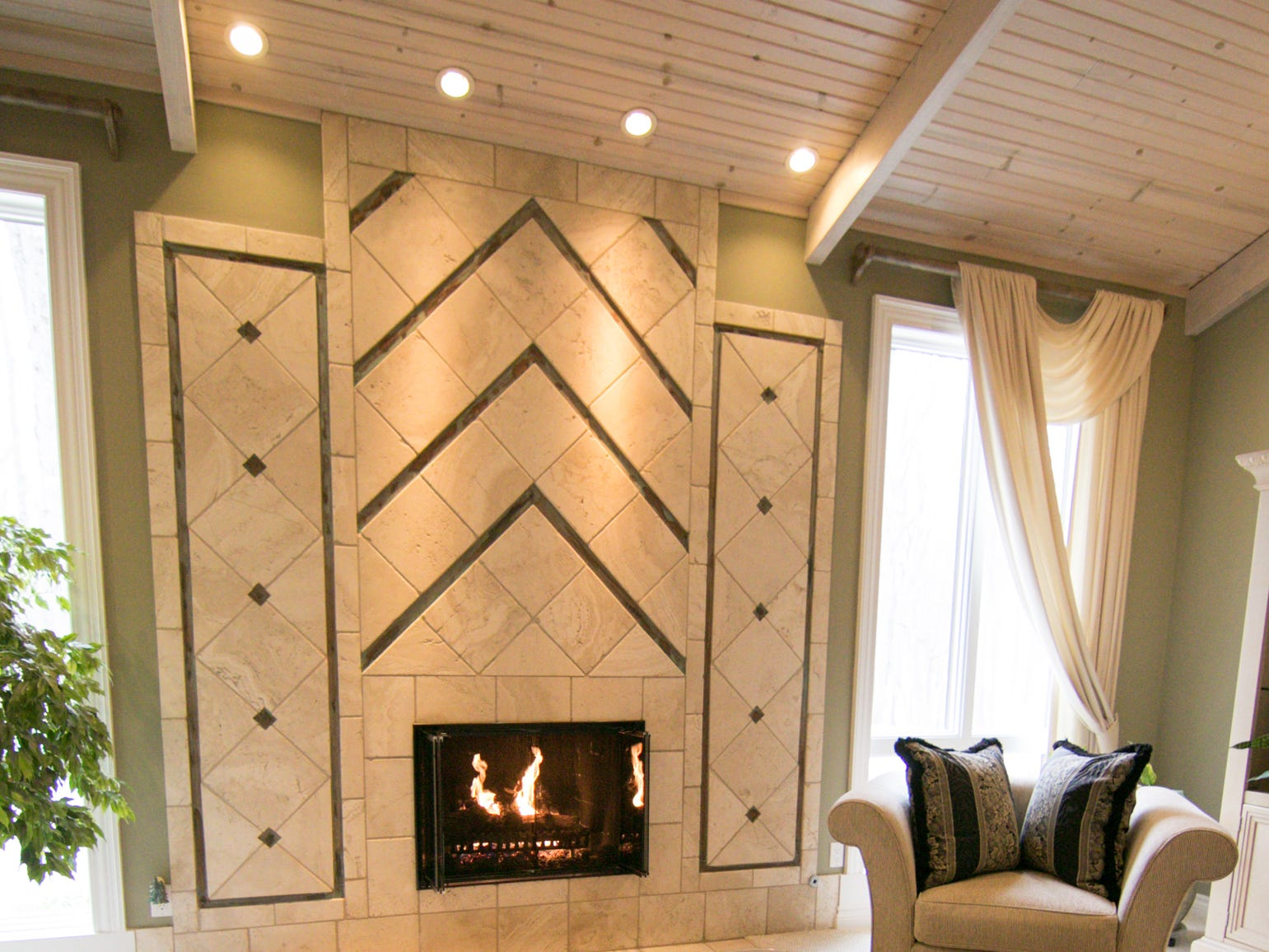 A fireplace and ceiling, shown Thursday, Jan. 17, 2019, were inspired by one of the homeowners' favorite restaurants.