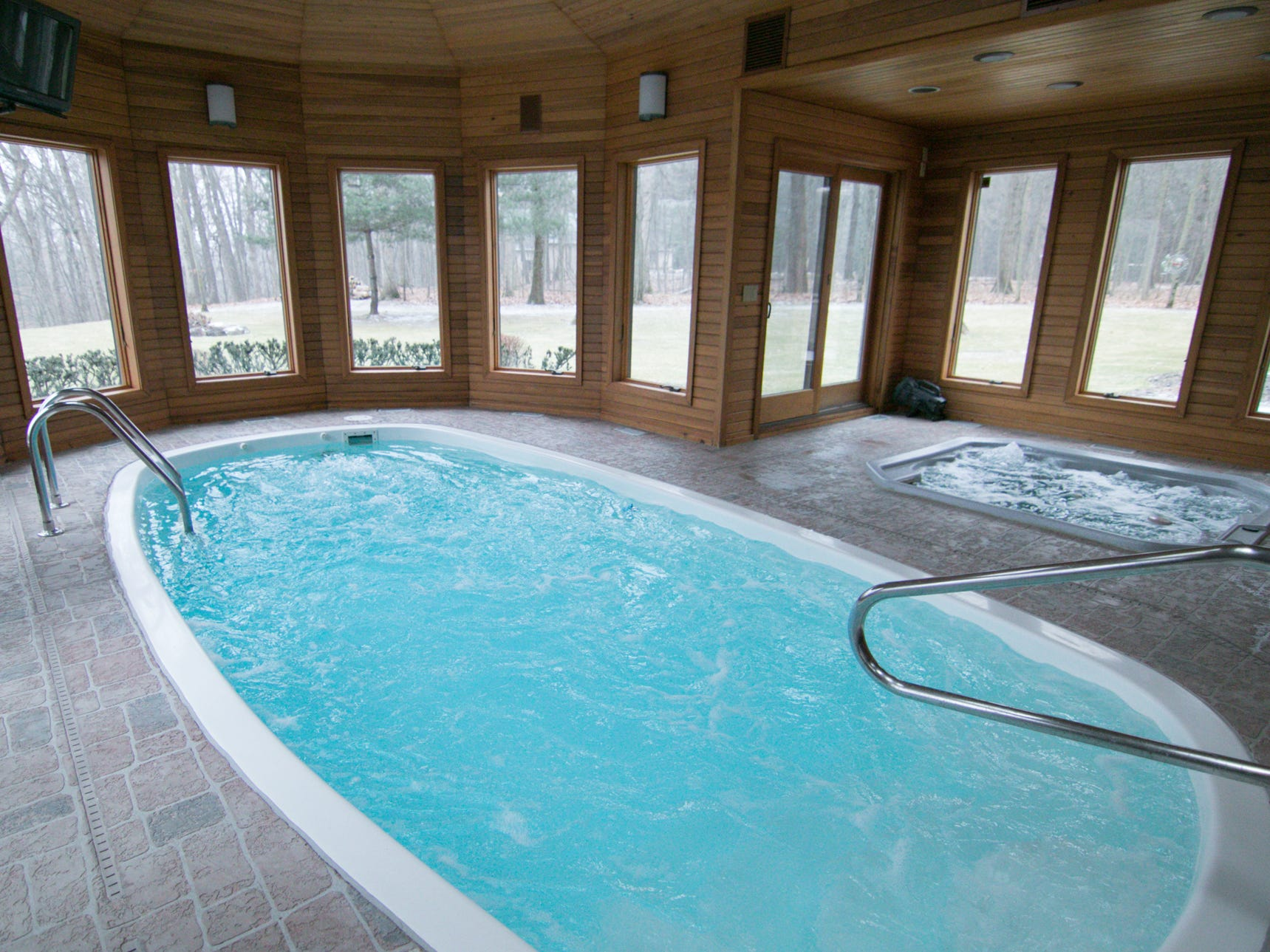 An indoor pool is heated to temperatures in the 90s, while the hot tub is over 100 degrees regardless of the weather outside of the Cross Creek Drive home, shown Thursday, Jan. 17, 2019.