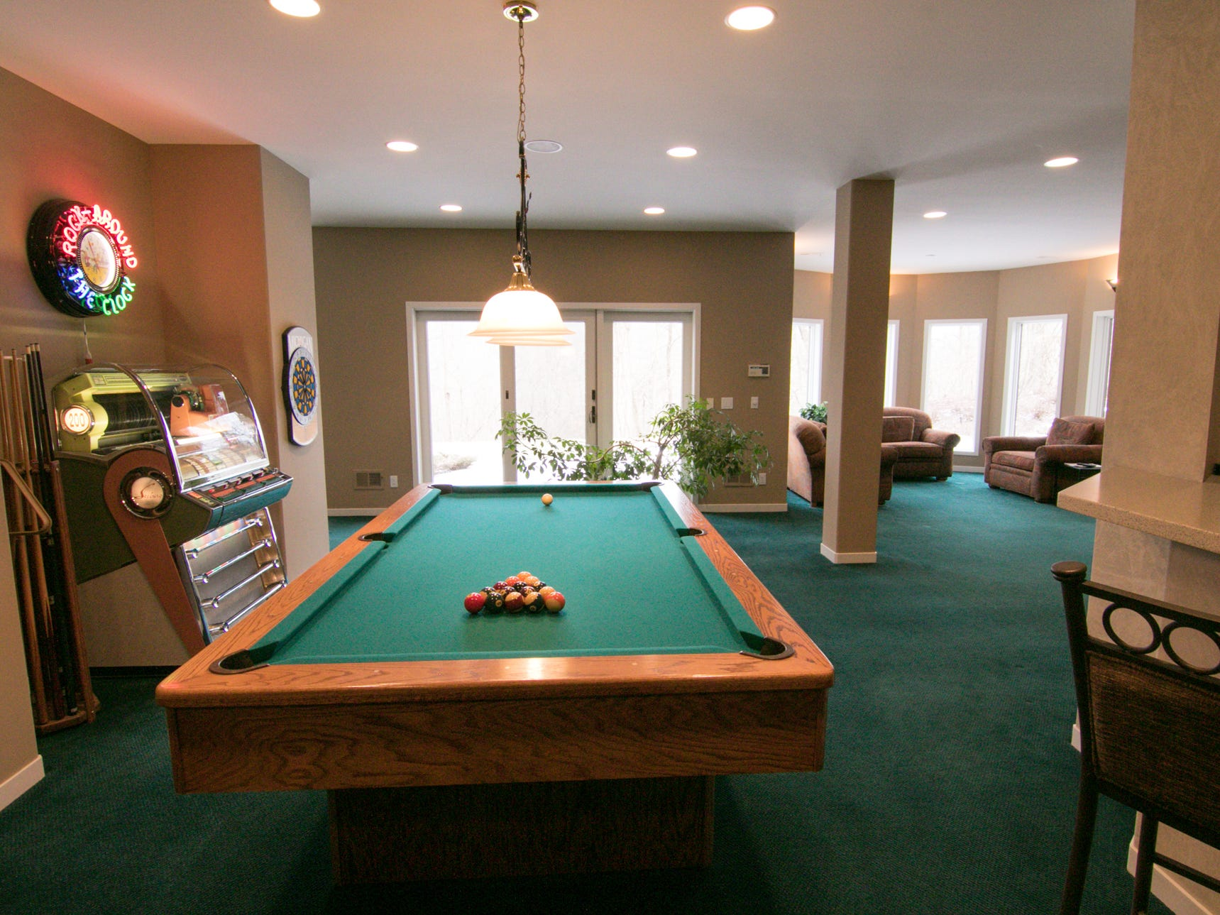 A recreation area in the basement of the Cross Creek Drive home, shown Thursday, Jan. 17, 2019, is decked out with a pool table, jukebox, full kitchen and other entertaining features.