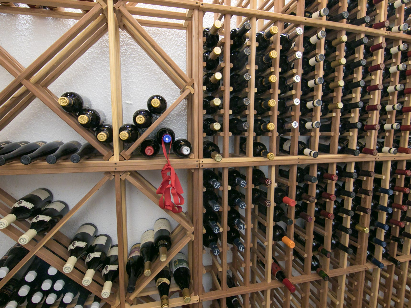 The wine cellar of the Cross Creek home in Green Oak Township, shown Thursday, Jan. 17, 2019, is stocked with fine wines.