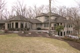 Ken and Debbie Abbott's 9,000-square foot, $2.2 million luxury home in Green Oak Township, MI features unique architecture, a wave pool and more.