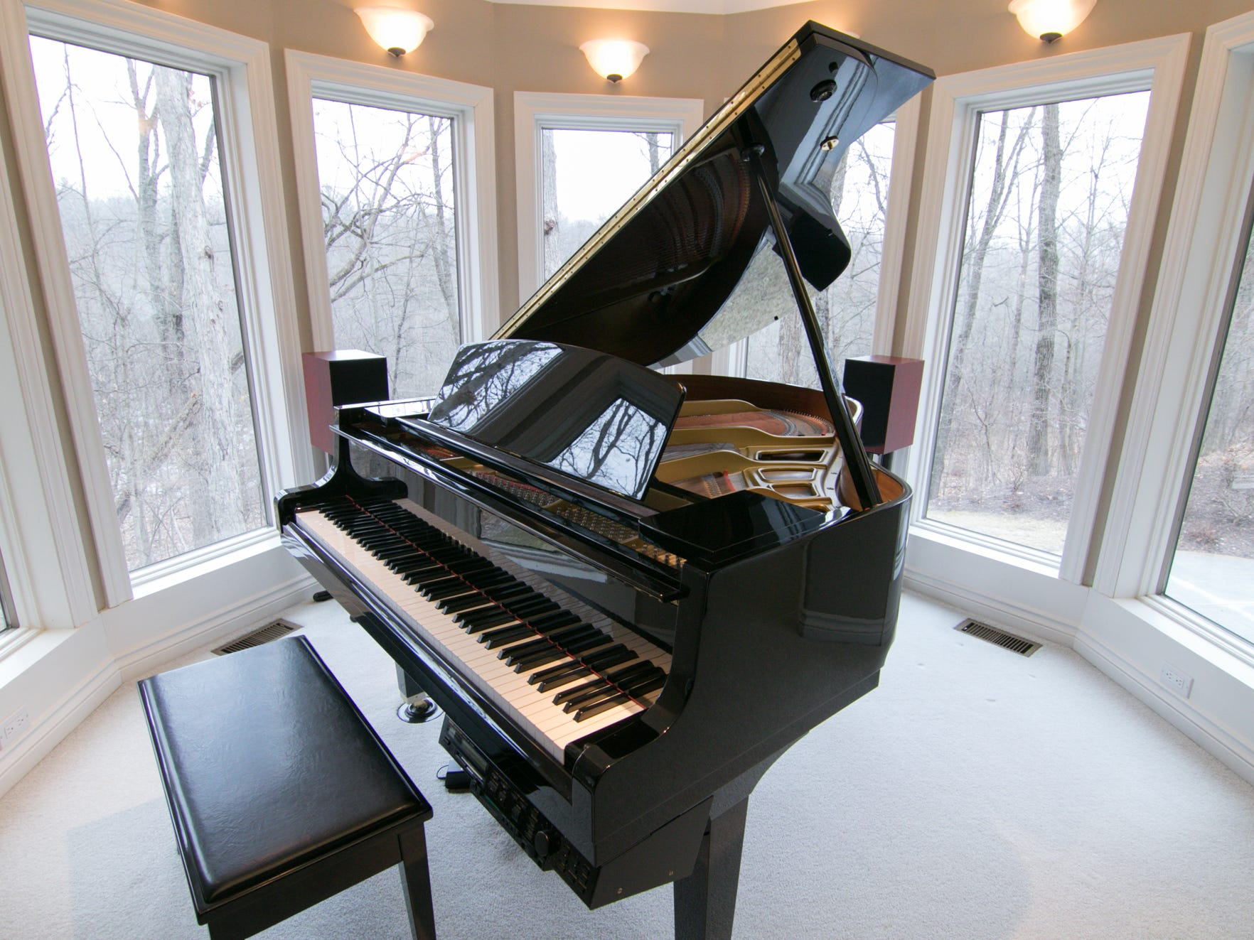 A grand piano is framed in an ideal location, one of a number of alcoves in the Cross Creek Drive home, shown Thursday, Jan. 17, 2019.