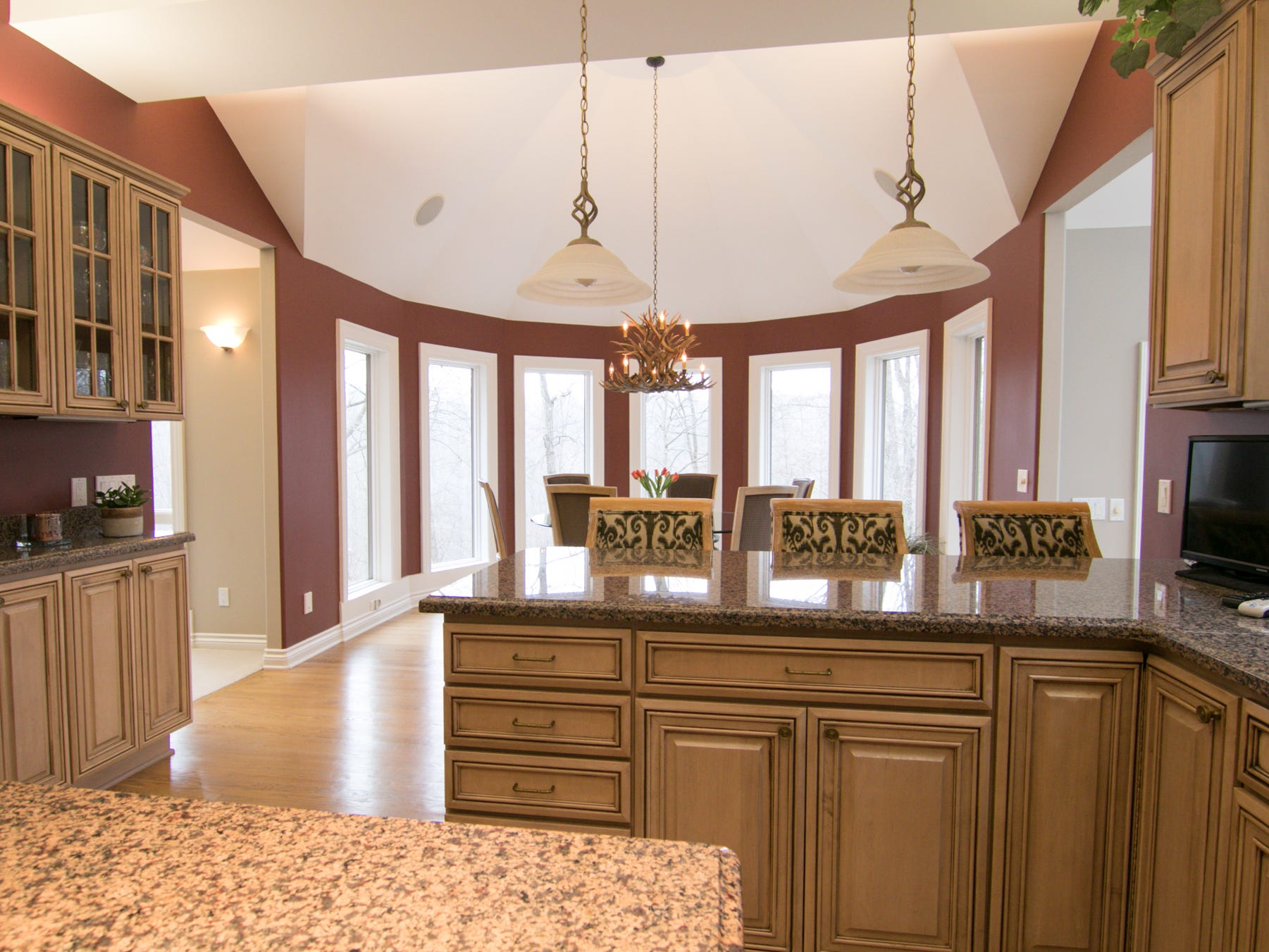 A custom kitchen overlooks a dining area that takes advantage of the view in the Cross Creek home, shown Thursday, Jan. 17, 2019.
