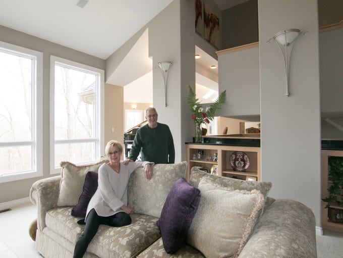 Ken and Debbie Abbott sit in the great room of their home on Cross Creek Drive in Green Oak Township Thursday, Jan. 17, 2019.